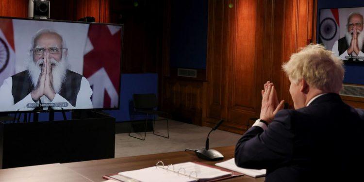 Premiê da Índia Narendra Modi participa de teleconferência com o primeiro-ministro britânico, Boris Johnson; na pauta, a tragédia da Covid-19 Foto: Andrew Parsons/Fotos Públicas